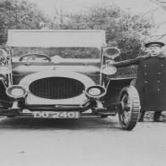 Riley car with chauffeur, c1910